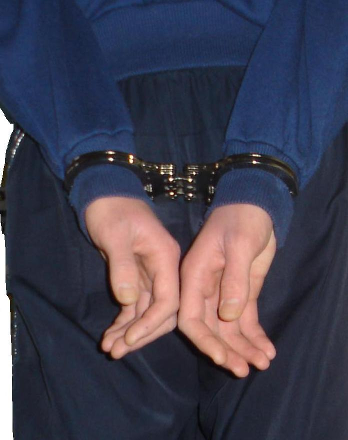 man handcuffed charged with assault